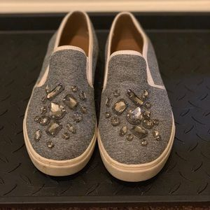 Blue jean and jeweled slip on loafers.